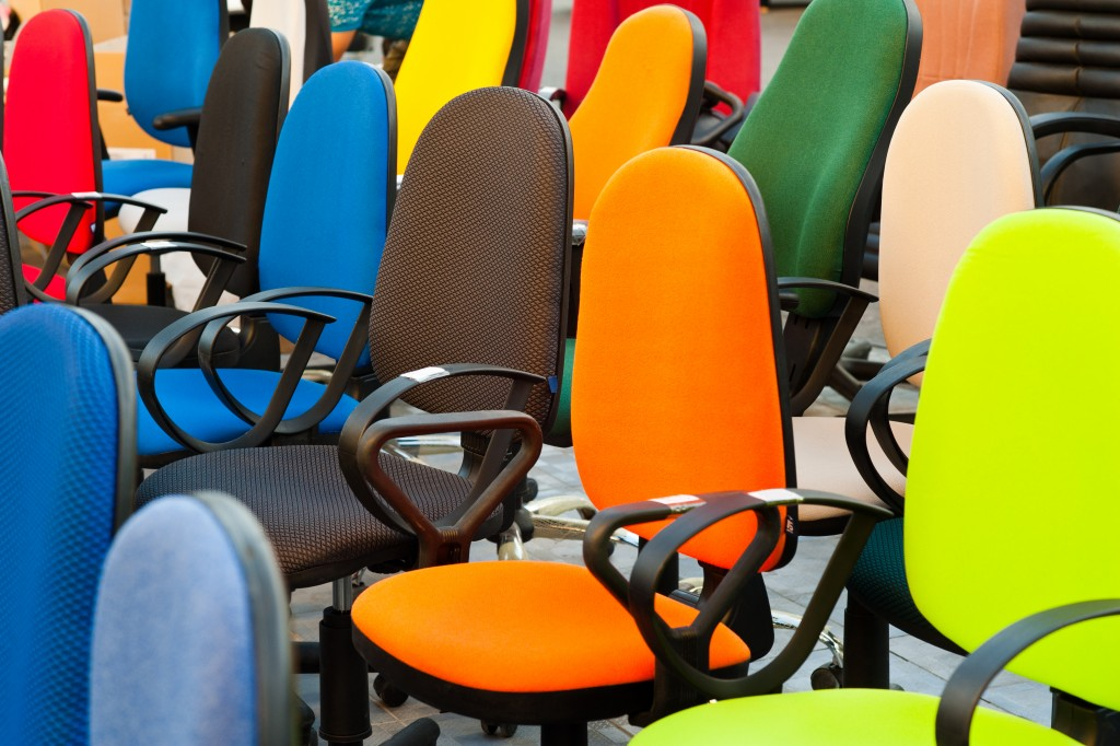 Multi-colored office chairs in a shop