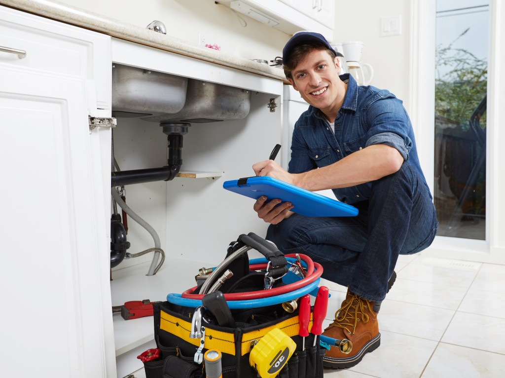 plumber fixing the faucet