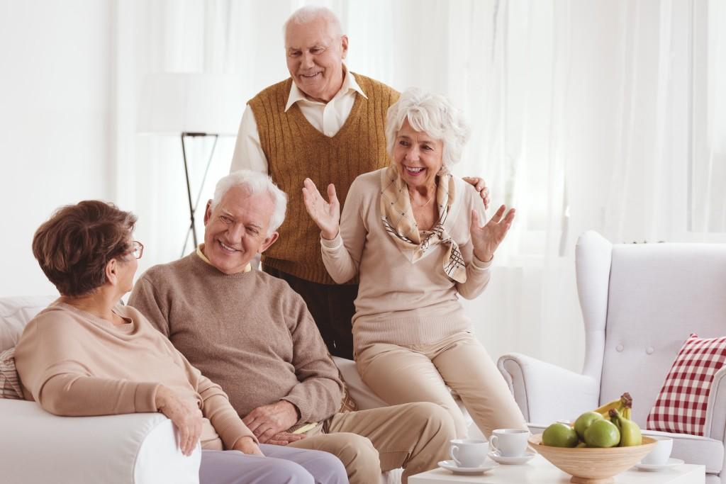 four elderlies talking in the living room