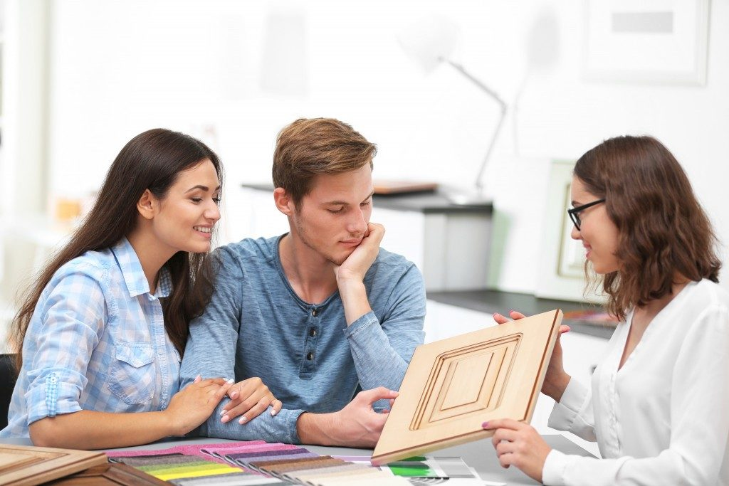 couple choosing decoration for home