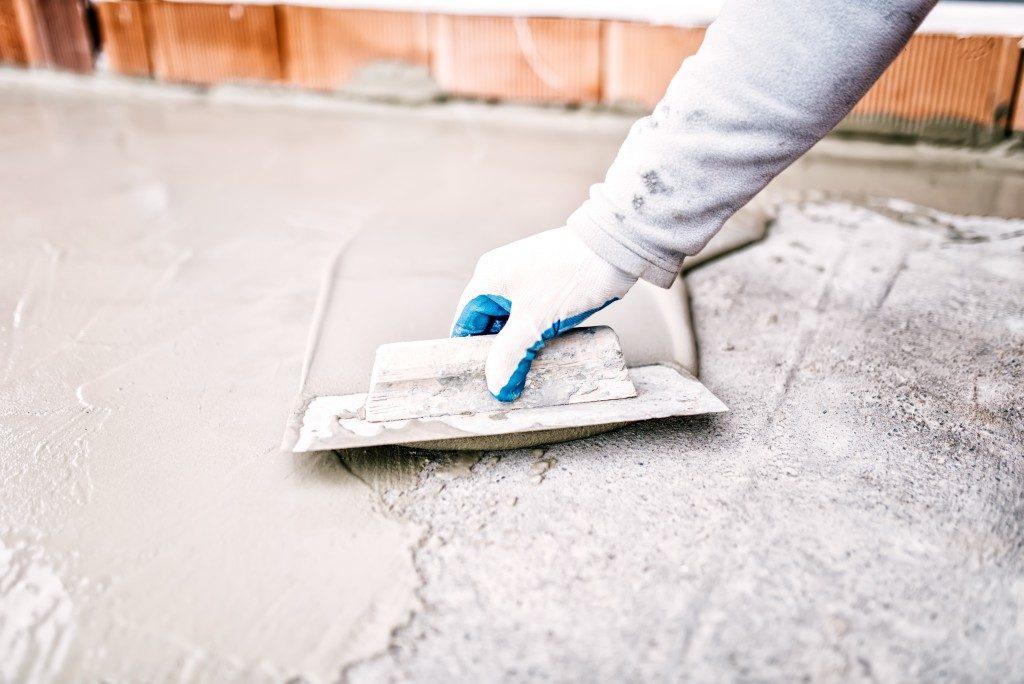 Hand spreading cement