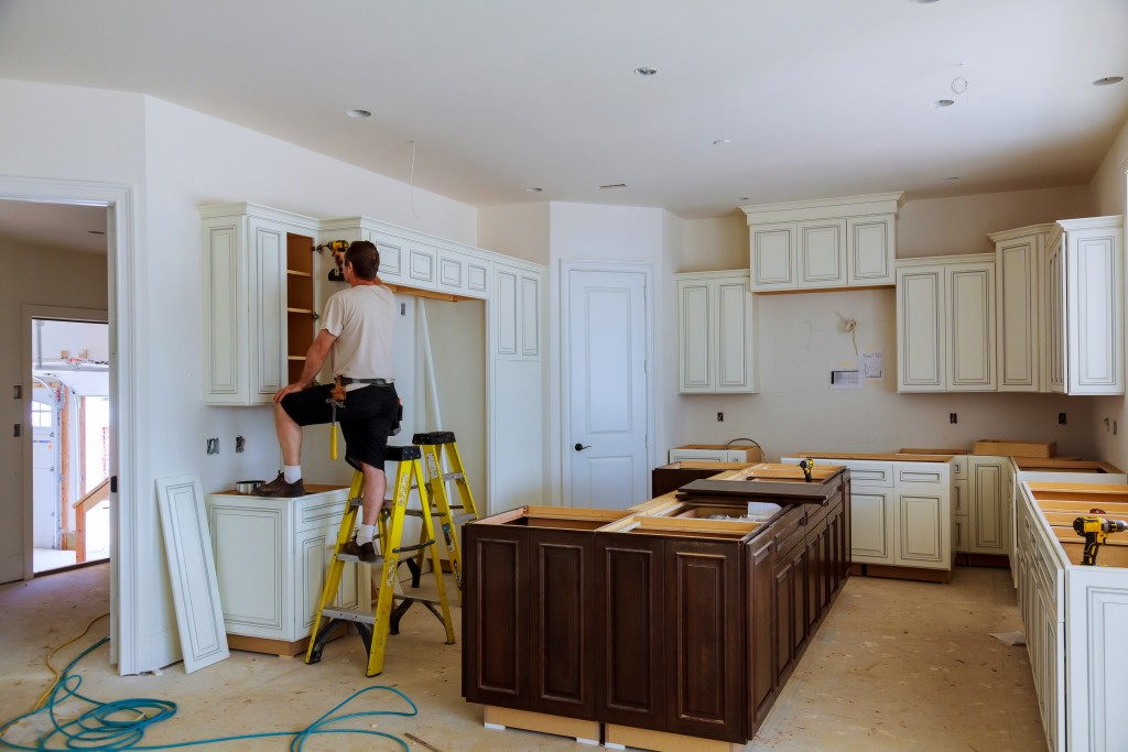 man remodeling kitchen