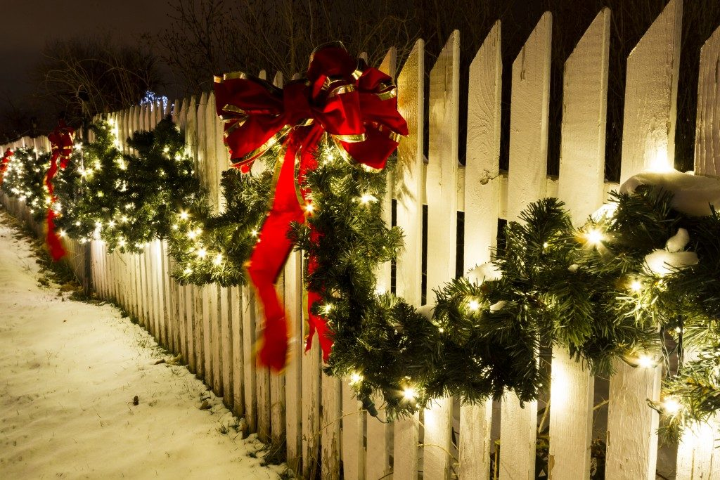 White wooden fence with Christmas decorations