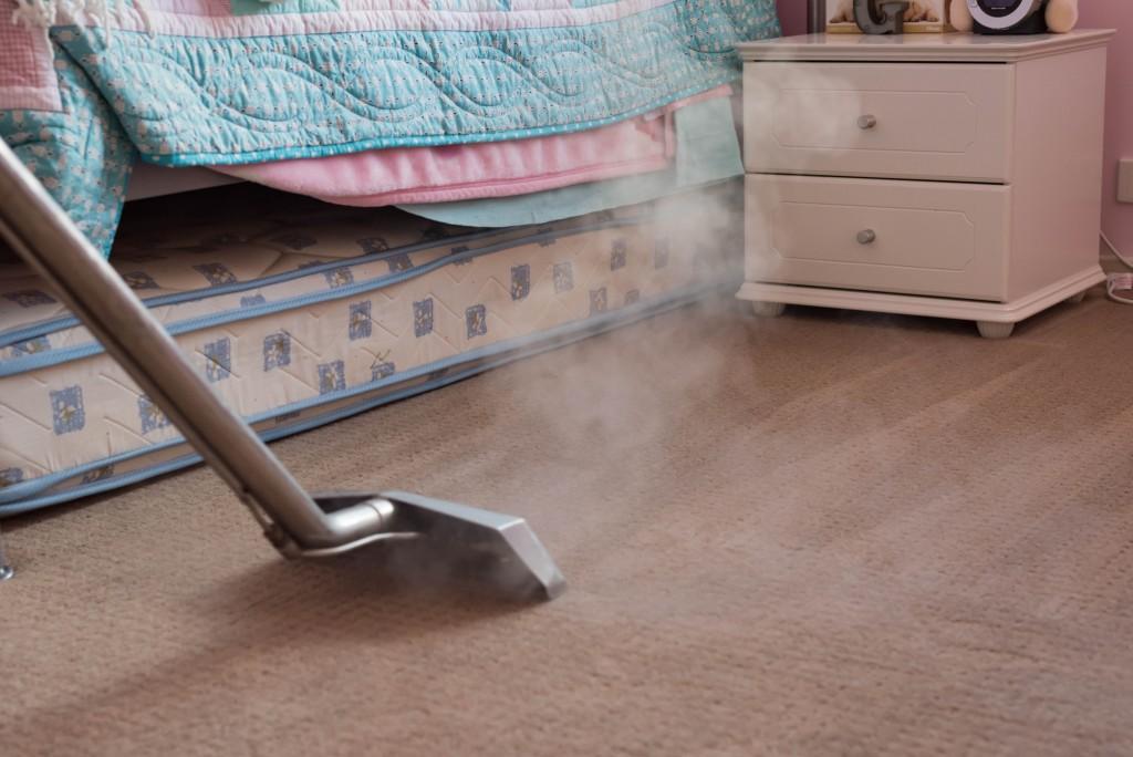 carpet being vaccumed