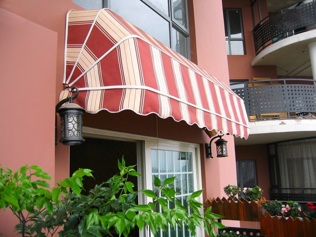white and red awning at the balcony