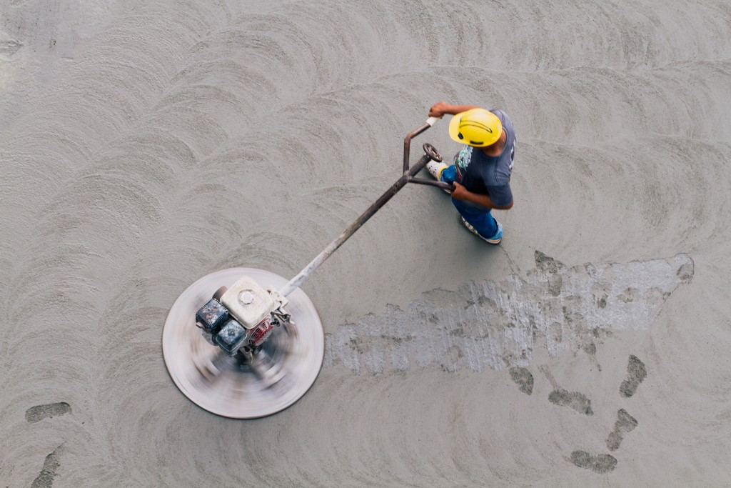 a worker finishing concrete on the job site