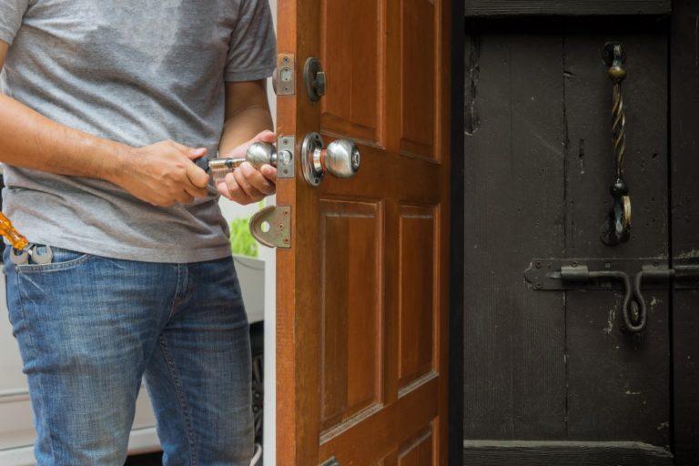 Man fixing locks of house