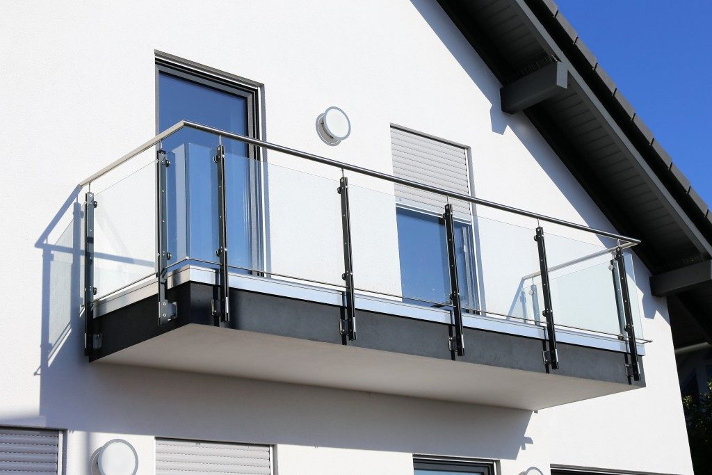modern home's balcony with railing and glass