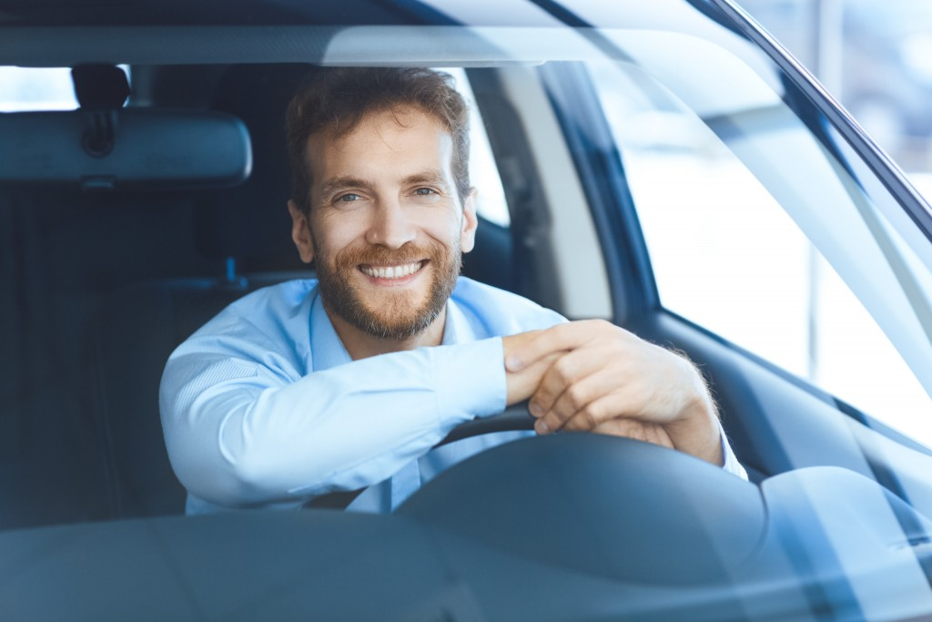Man sitting in his car