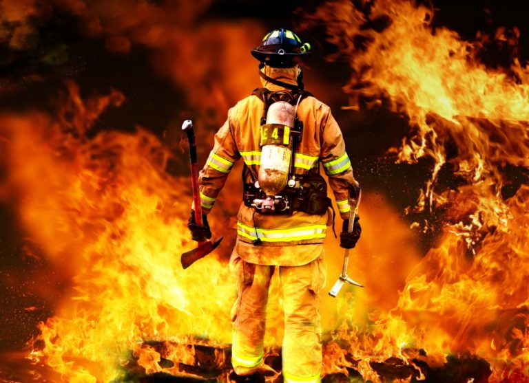 Firefighter looking at the flames