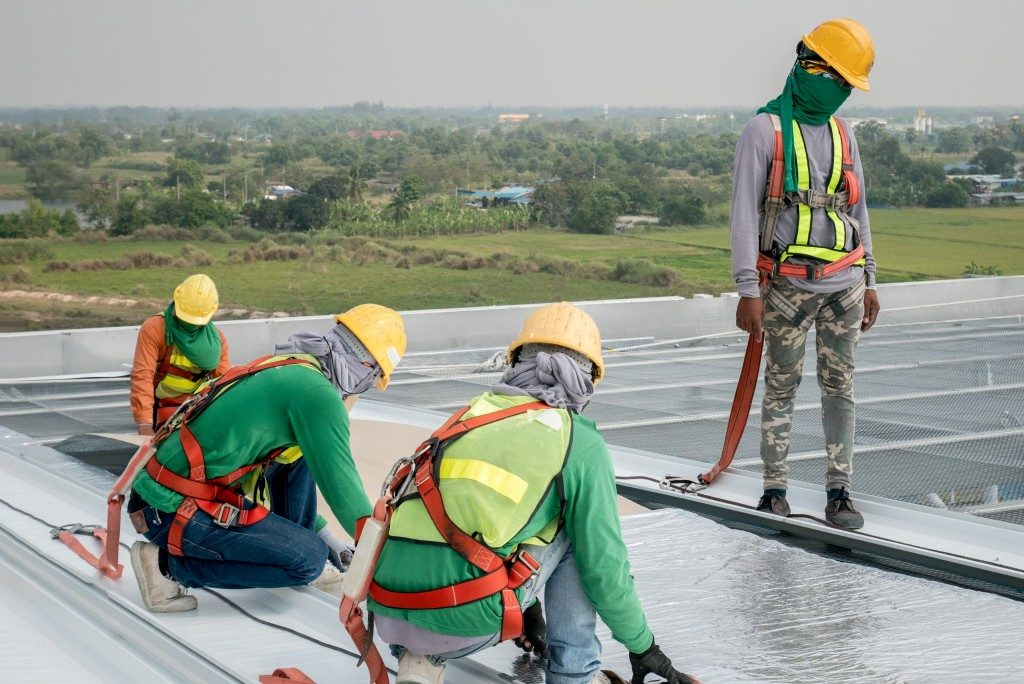 workers installing a commercial roof