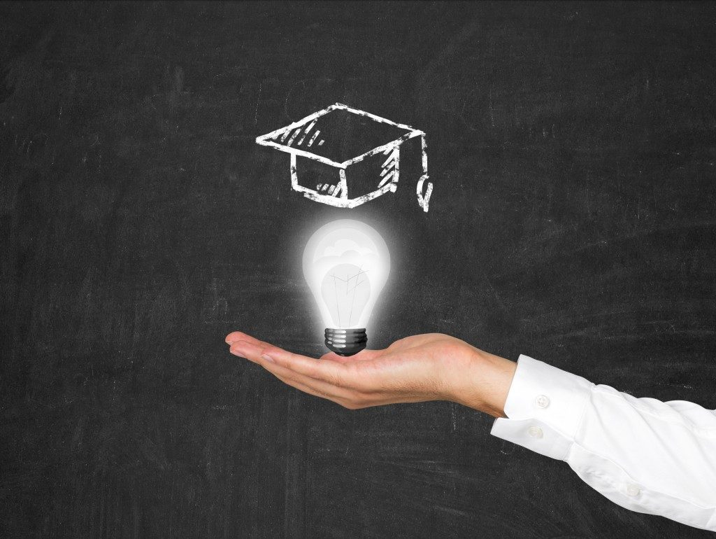 education concept with lightbulb and toga cap