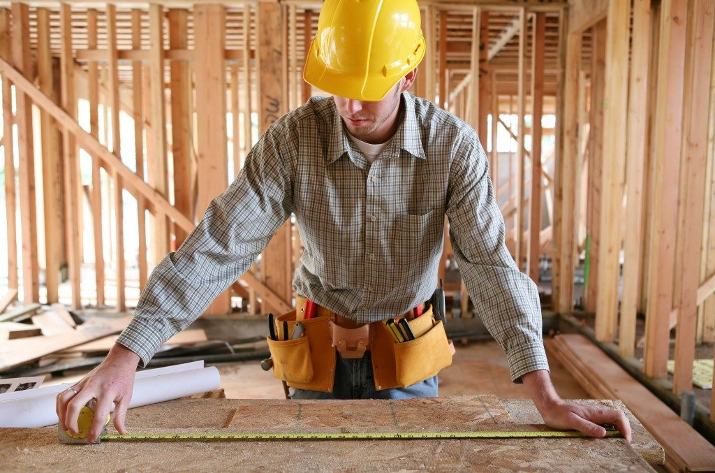 measuring wood panel for home construction