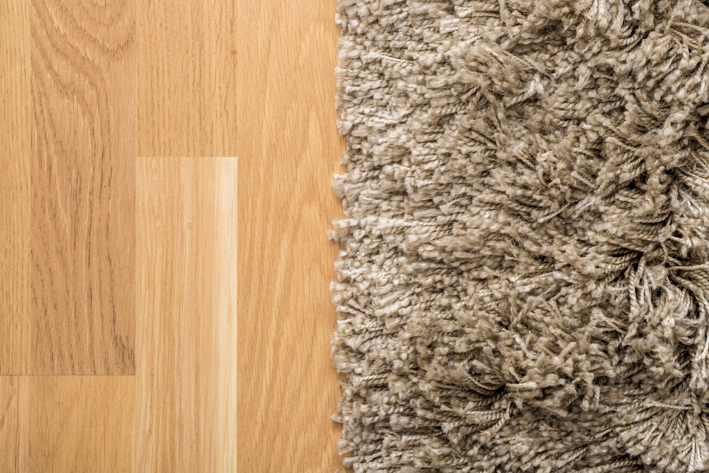 Carpet on wooden floor