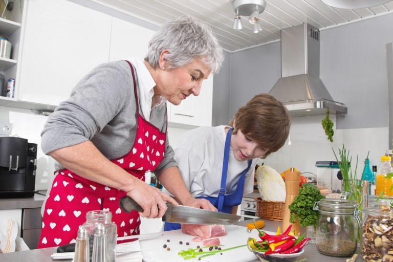 Old woman teaching how to cook