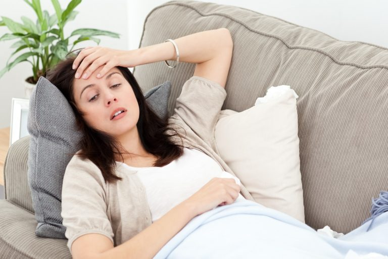 woman on the couch feeling distressed