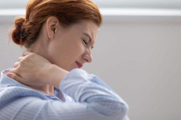 woman having stiff neck