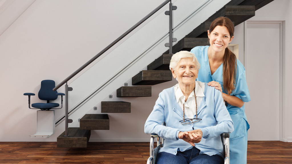 senior woman at home with nurse